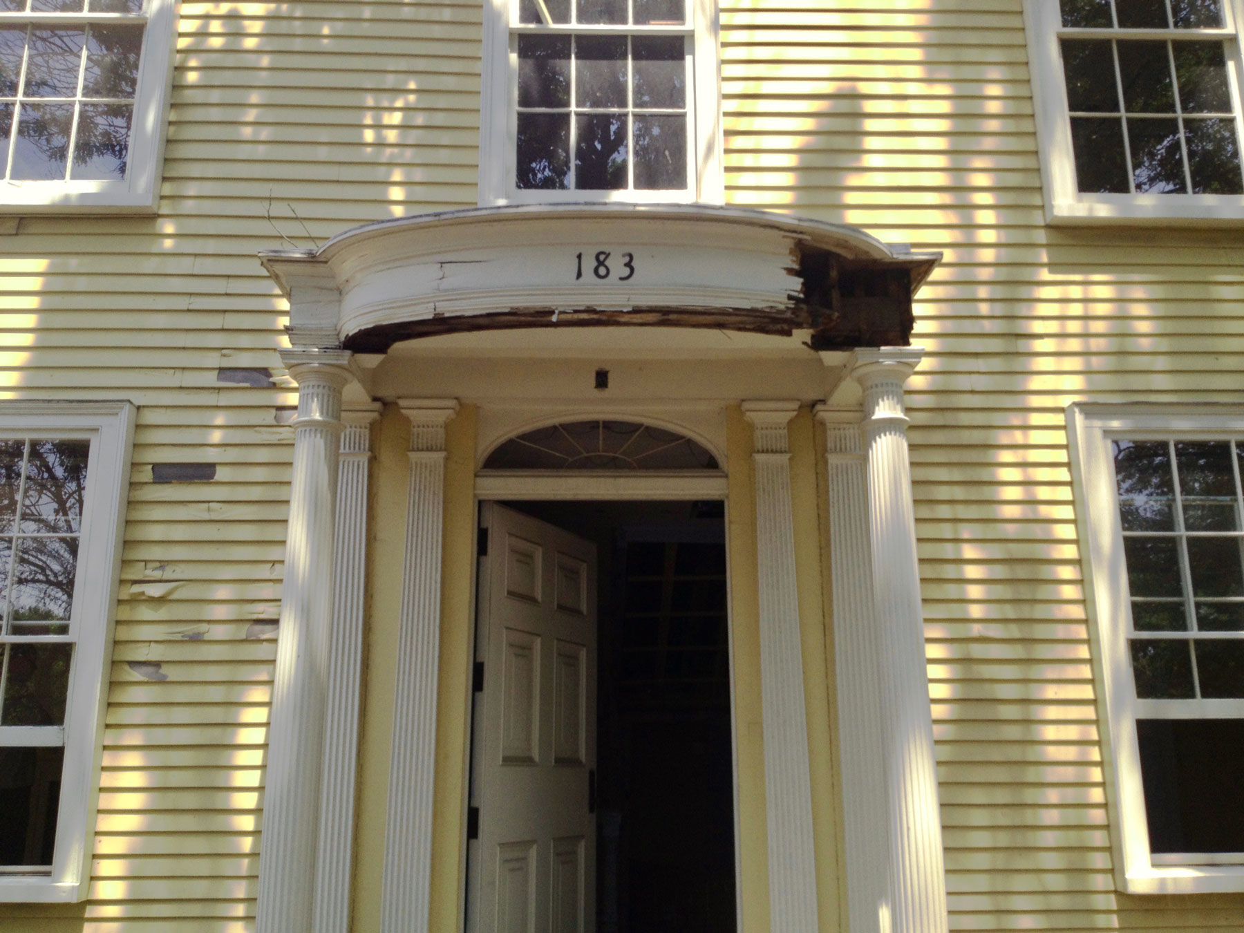 Dillaway Thomas House Doorway renovation 183 Roxbury Street, Roxbury Crossing, MA . Bonding with clients over historical finishes